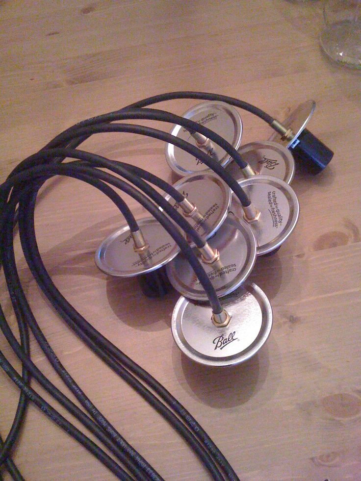 buy 18/2 black cable, cut it to size, run it through the mason jar lid, & attach a lamp socket to the end.