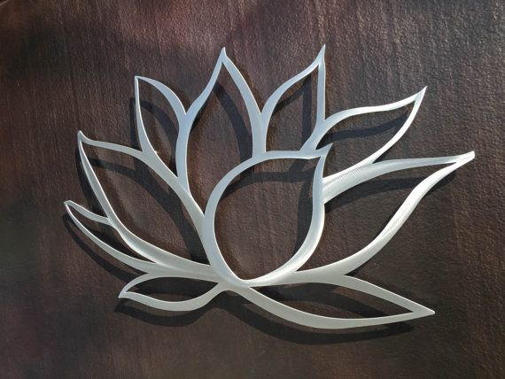 The lotus flower symbolizes awakening to the spiritual reality of life. The lotus flower is a symbol of purity, self-transcendence, and expanding consciousness.