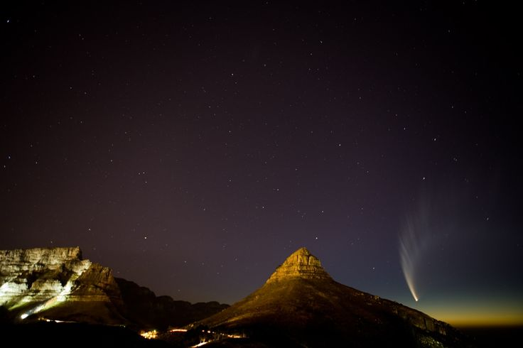 Comet McNaught dipping behind Lion's Head. How incredible??!