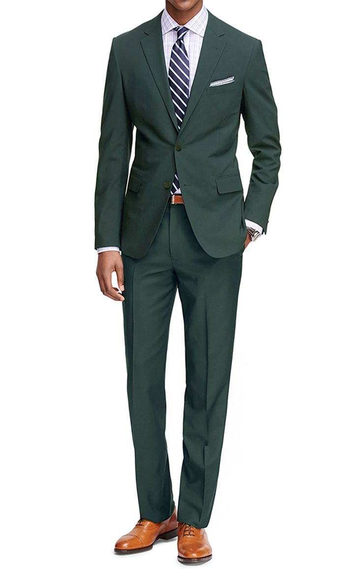 This hunter green men's suit has a classic fit and pairs well with navy and brown accessories