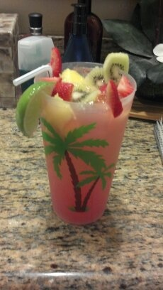 2 shots kettle one vodka, 6 oz zico coconut water, 4 oz go girl, 4 oz guava nectar, fresh pineapple, kiwi, strawberries, mango, and a lime slice = PERFECTO!