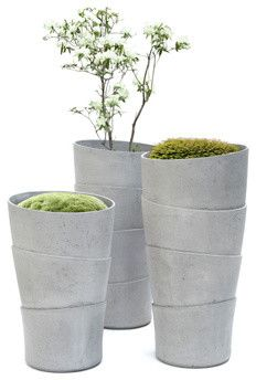 Love these planters!  The hand-wrapped design of Rainer Mutsch's gorgeous Palma planters adds a wonderful bit of art to any outdoor space. I love how the rugged fiber cement material contrasts with plants, and they look just as great indoors as they do out.