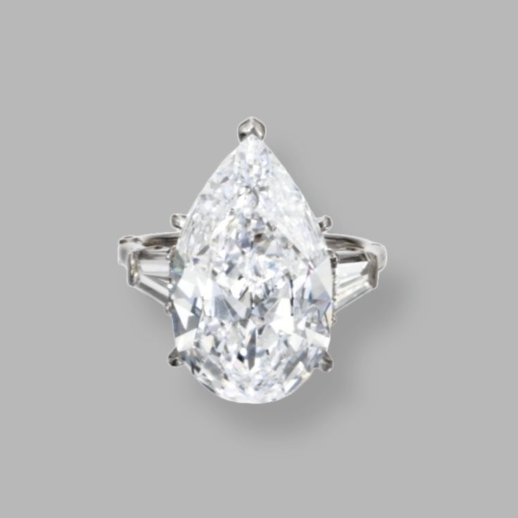 Trendy Diamond Rings :    PLATINUM AND DIAMOND RING, HARRY WINSTON, 1967 The pear-shaped diamond weighing 7.06 carats, flanked by tapered baguette diamonds weighing approximately .70 carat  - #Rings https://youfashion.net/wedding/rings/diamond-rings-platinum-and-diamond-ring-harry-winston-1967-the-pear-shaped-diamond-weighing/
