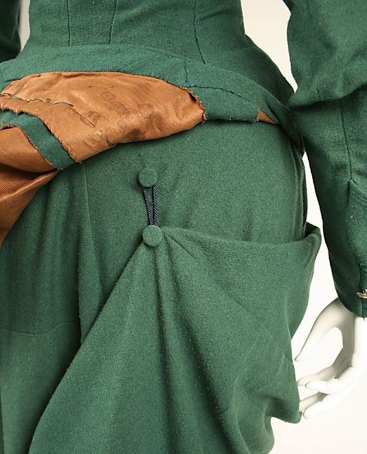amazing detail for a draped skirt (and lovely hints of the seaming on the upper skirt portion, too, in this photo, as well as lining) Green Riding Habit, circa 1875, American (detail)