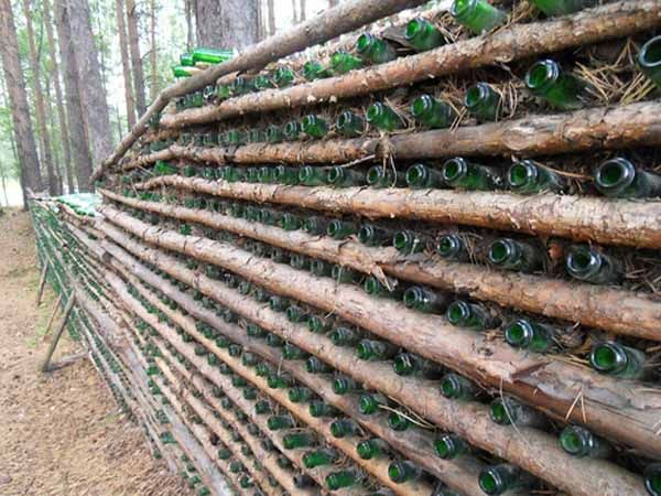 Plastic And Glass Recycling For Fences Built Of Empty