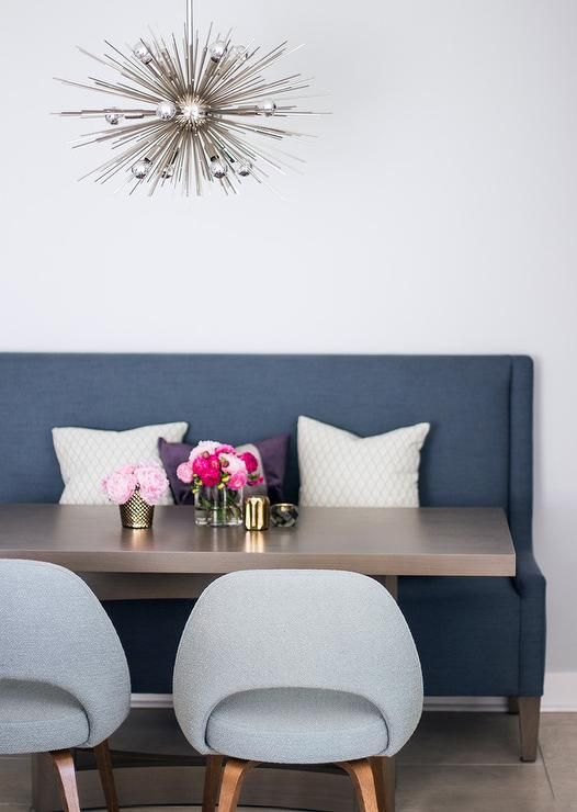 settee for kitchen table tile countertop contemporary dining space features a blue wingback paired with brown rectangular also seating two saarinen exe