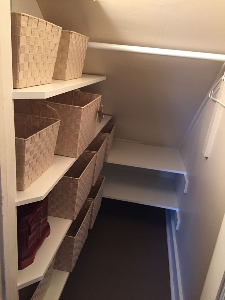 "This is what we did with a closet in our Cape Cod house - a closet built into the side of a dormer. Shelves are 12"" wide. The back shelf is 24"" deep and about 40"" wide total - enough for large plastic storage bins. We added woven baskets on the shelves in a light color and will also add tags."