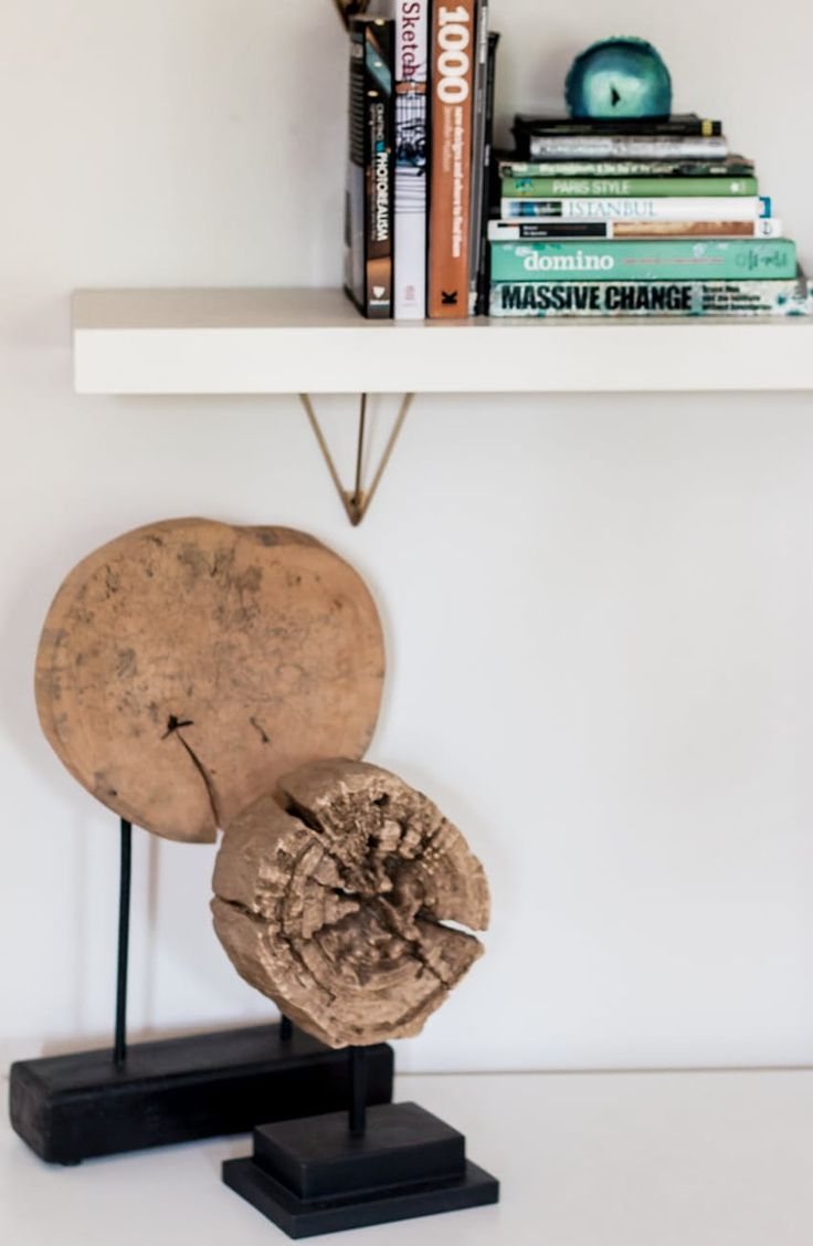 jess elevated her ikea lack shelving in her living room using west elmu0027s antique brass prism