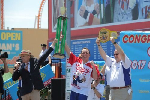 Nathans Famous Fourth of July hot dog eating contest in...  Nathans Famous Fourth of July hot dog eating contest in pictures  Joey Jaws Chestnut gulped chomped and powered his way to a 10th title on Tuesday continuing his record-setting reign as the chowing champion at the annual Nathans Famous July Fourth hot dog eating contest.  Shoving water-soaked buns and wriggling franks into his mouth on a hot sunny day on the Coney Island boardwalk he downed 72 dogs and buns in 10 minutes to beat his…