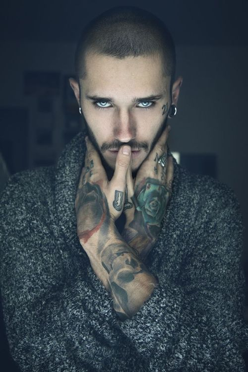 Wow. Tattoos and look at those eyes!