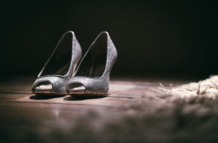 Laura's silver wedding shoes in beautiful light.