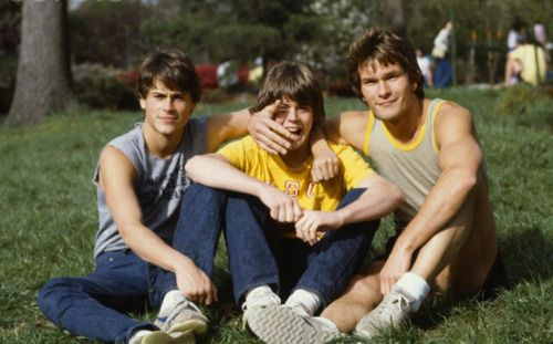This is Rob Lowe, C. Thomas Howell and Patrick Swayze. It's weird seeing their hair all not- greasy.
