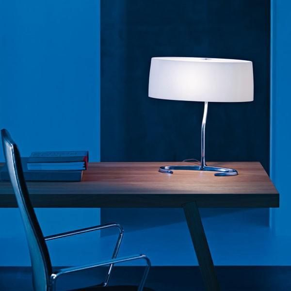 The foscarini esa table lamp is an elegant table lamp with base in polished aluminium and diffuser in blown satin glass