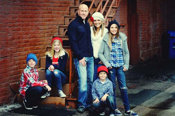 I like the laid back, stylish look with this family. Usually, I avoid plaids and other busy patterns, but here it works. I think there are a few too many hats though.