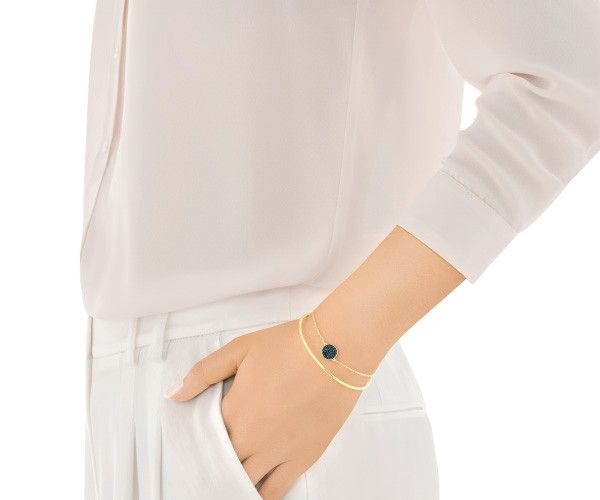 Inject color into any outfit with this two-in-one layered design, featuring a rigid bangle attached to a delicate chain with a blue crystal pavé... Shop now