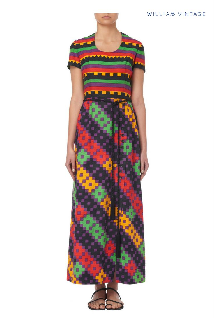 A Lanvin maxi dress from circa 1965, constructed in a honeycomb cotton and featuring a geometric multi-coloured pattern.  The skirt has a split to the front, and the waist ties with black rope belt.  Discovered by William Vintage.
