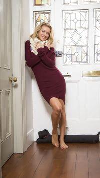 Rachel Riley in a comfy dress in front of the door Celebrity mobile wallpaper
