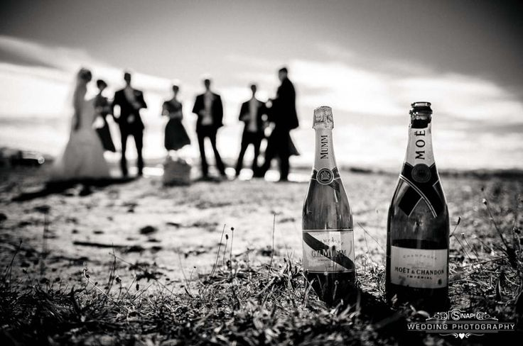 Moet. With bridal party out of focus in the background. More wedding photography by Anthony Turnham at www.snapweddingphotography.co.nz