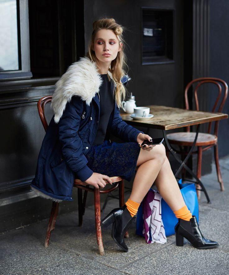 Oversized navy parka with soft faux-fur lining worn with black Chelsea boots, all Savida by Dunnes Stores