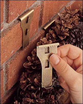 Brick Clip® - Gardening For hanging things outside on brick walls, or inside on fireplaces, without drilling holes.