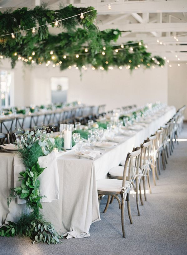 elegant wedding table runner with greenery details