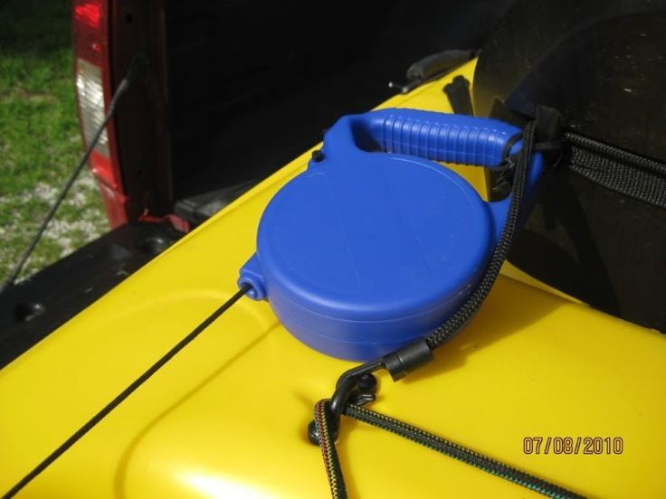 Check out this website for tips on making your own kayak anchor using a retractable dog leash...