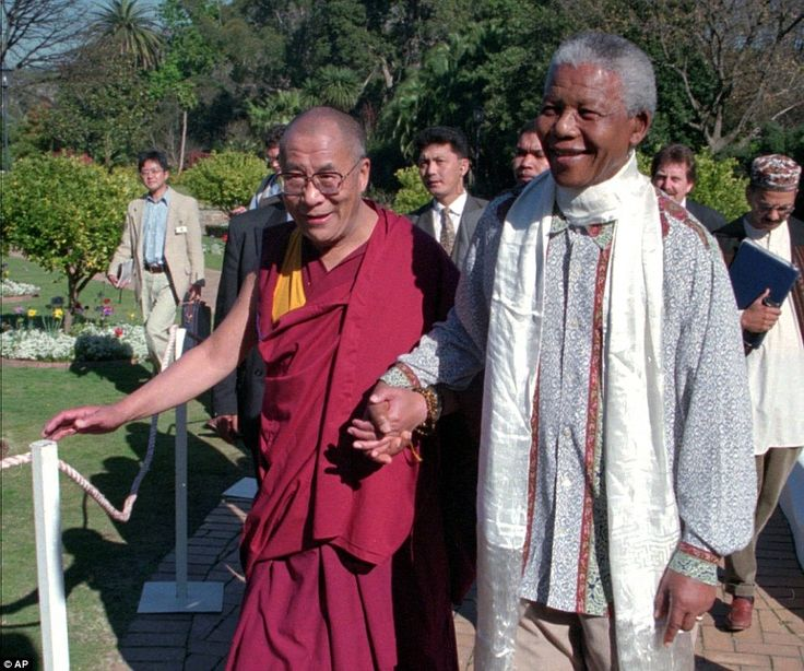 Moral authority: In this Aug. 22, 1996 file photo, the Dalai Lama, left, walks hand-in-hand with South African President Nelson Mandela prior to an official reception at the presidential office in Cape Town, South Africa.