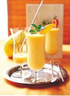 "Tropical Papaya Smoothies have a skinny 150 calories per serving. The recipe is one of more than a hundred in ""Betty Crocker Smoothies.""  General Mills © 2015"