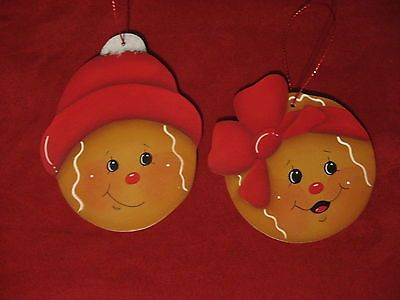 HP HANDPAINTED GINGERBREAD ORNAMENTS RED HAT AND BOW.