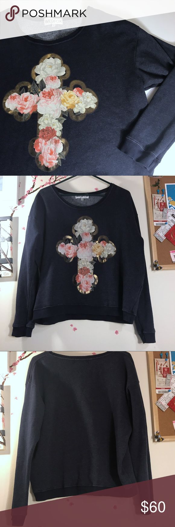 Wildfox Navy Jumper Floral Gold Cross Stay cozy in this fleecy oversized Wildfox sweater! Intentionally faded and pilled fabric. Features a beautiful Floral Print in the confines of a gold cross on a navy background. Writing on tag. 70% cotton, 30% polyester. Size small. Pre-owned.   24 in flat bust 23 in shoulder to hem 20 in arm length from pit Measurements are approximate; please allow for human error!  Smoke-free home / No trades / Priced for offers Wildfox Sweaters Crew & Scoop Necks