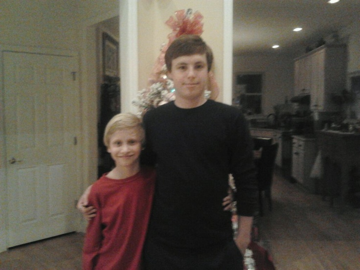The boys in front of the Christmas tree. They are getting so big that you can't even see the tree.
