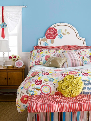 blue walls and colorful bedspread