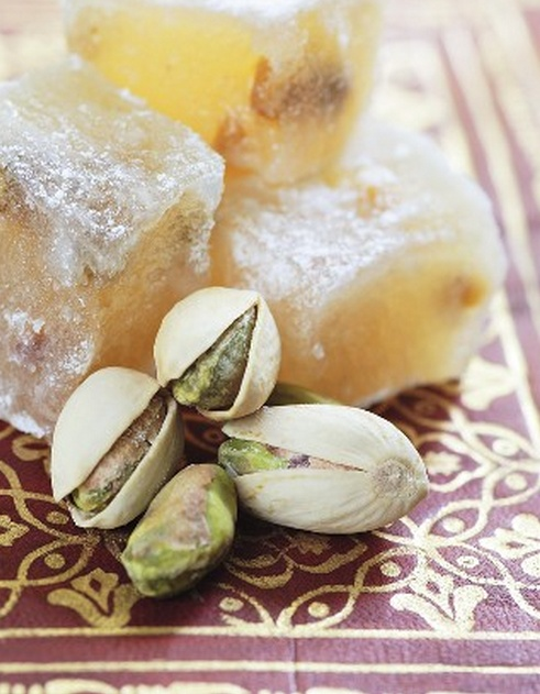 Lokum (w/pistachios) or also called Turkish Delight is a confection based on a gel of starch + sugar & eaten as small cubes dusted w/icing sugar