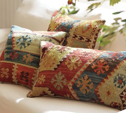 I love Kilm-rug-like pillows and upholstered ottomans/footstools of the same.