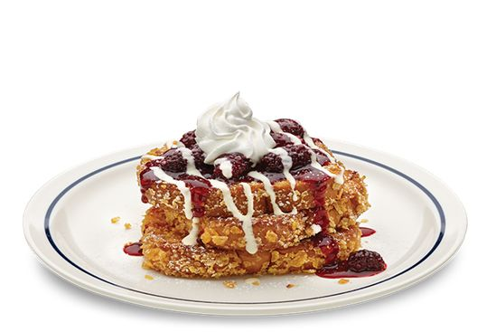 Blackberry & Vanilla Double-Dipped Brioche French Toast | You get double the fun when we dip thick slices of brioche once in our vanilla batter, and again in our cornflake and oatmeal mix. We put the finishing flavor touches on top with plump blackberries and a drizzle of sweet vanilla sauce.