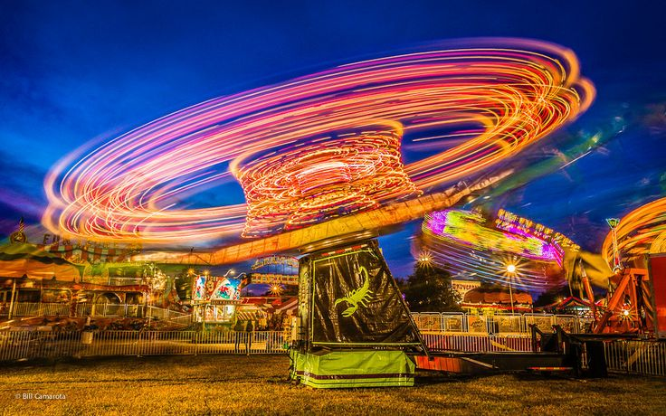 "The Scorpion - Simply and amazing capture of light. A County Fair in Venice, Florida from one of our very talented photographers. Brighten up your home or office & purchase this on Fine Art Canvas, a 3/4"" Gallery Mount, Pro Lustre Print or Infuse it on Aluminium @ www.burdseyeview.ca"