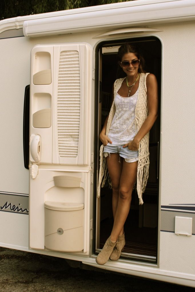 Faded jean shorts, chic long crochet vest over a loose-fitted white tank. Especially love the beige booties.