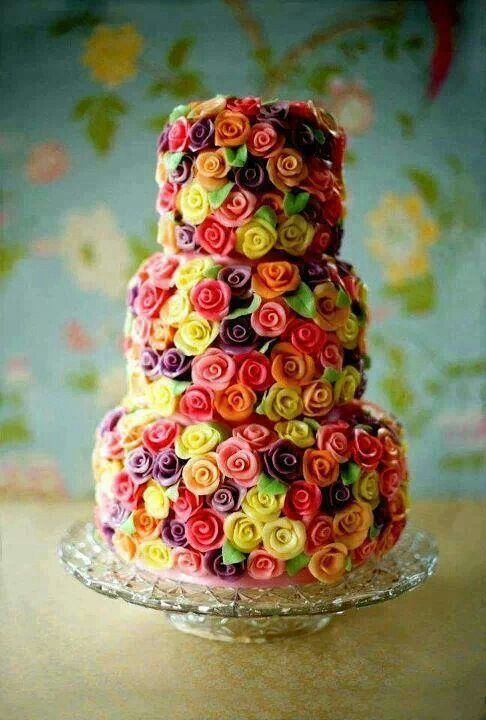 Completely cover one tier with little sugar flowers?