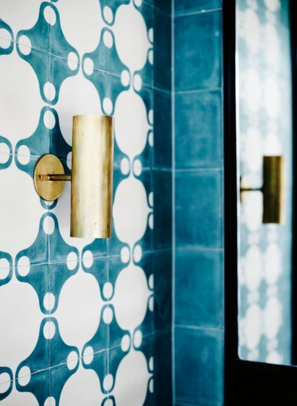 The home and work of Melbourne artist Anna Charlesworth: Charlesworth's 'Brass Can Wall Light' in the bathroom.