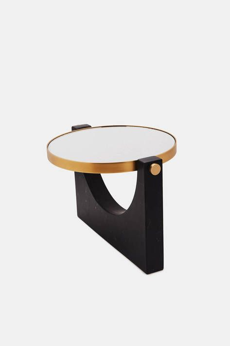 In creating this tabletop mirror for Menu, Milan-based Studiopepe looked to Italian design of the late 1950s, especially the work of Gio Ponti, Luigi Caccia Dominioni, and Carlo de Carli, who elevated quotidian objects with sleek forms and precious materials. The disc of mirrored glass—one side magnifies (3x) and the other does not—is framed in brass and set in a streamlined stand of black marble.