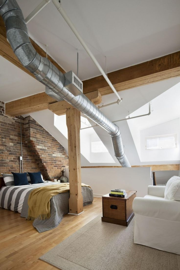 fabulous small attic bedroom ideas with brick stone wall decor beside bed including white gray duvet cover plus rug on wooden floor beside white sofa