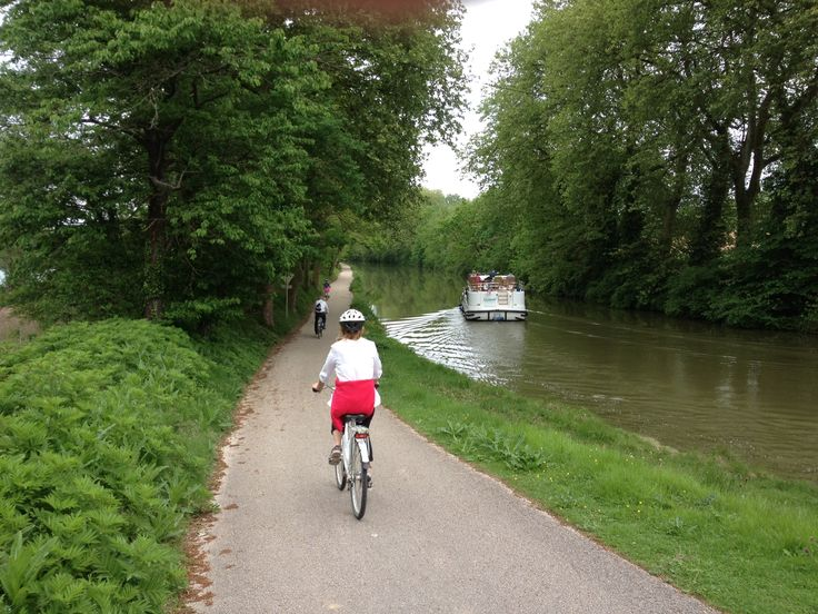 Cycling along the Canal Du Midi in the South of France in May 2015 near the Port de Lauragais.