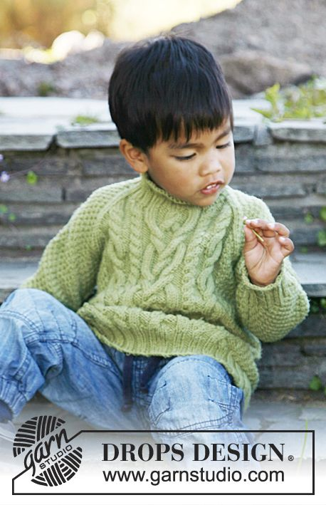 """Free pattern: Knitted DROPS jumper with raglan, cables and double seed st in """"Merino Extra Fine"""". Size 3 to 12 years."""