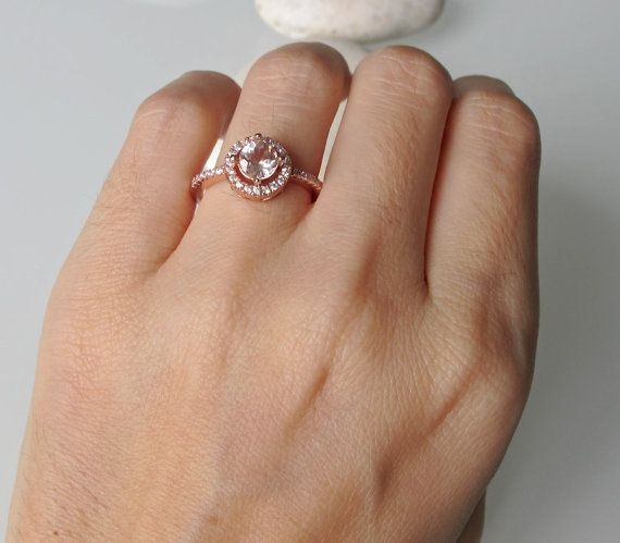 A classic halo setting featuring a Stunning Morganite complemented with cubic zirconia band in rose gold plated over sterling silver. This ring makes a lovely engagement/promise/anniversary ring. Wrapped in a Box ready for gift giving.(r-egt-6-th)  Morganite measure 6mm, weighs 0.90cts Shank width at the narrowest section 1.33mm Ring Height with stone 6mm  *FOLLOW* us on Twitter https://twitter.com/#!/Belesas to get more exclusive coupon code *Pin it to Win it on Pinterest…