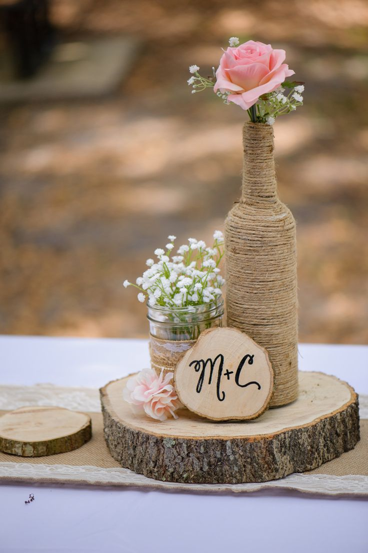 Mason jar, twine-wrapped bottle, pink rose, baby's breath, white lace, tree trunk slice, rustic wedding centerpiece // The Canovas Photography