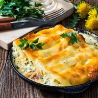 Chicken manicotti stuffed with spinch and ricotta cheese