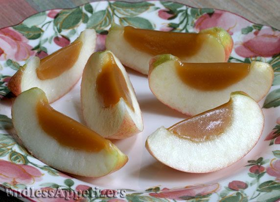 Halved fresh apples filled with homemade caramel; chilled, then sliced into easy individual finger food servings.