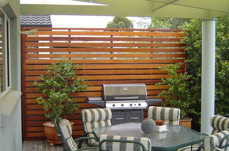 Privacy fence with modern lines. Don't like the furniture, just the fence.