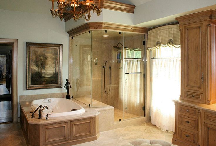 We balanced #OldWorldStyle with modern #luxury in this #Tulsa bathroom remodel -- adding in a 42-inch Kohler whirlpool tub, two-person walk-in steam shower and Knotty Alder Cabinetry. #homeremodel #bathroomremodel #bathroomdesign #bathroom #bathtub #walkinshower #stonefloor #luxurybathroom #spabathroom #contractor #design #renovation #remodel #homeimprovement #interiordesign #style #tuscan #oldworldstyle #homedecor