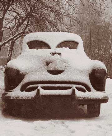 ODD CARS..or in ODD PLACES, ODD PREDICAMENTS....No doubt grumpy about the snow